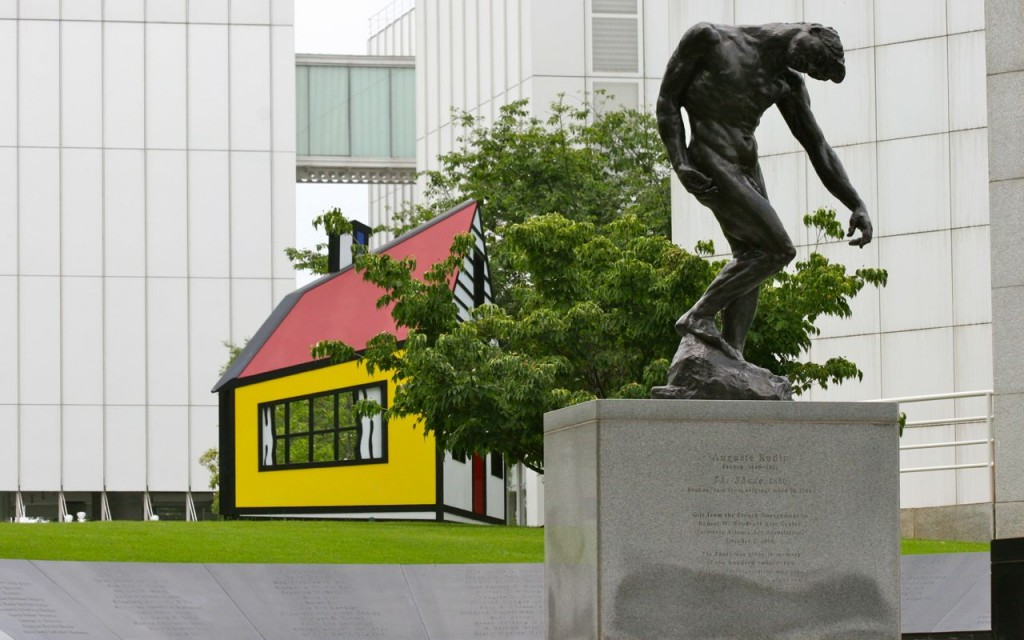 "A statue by Auguste Rodin (French 1840-1917) called ""The Shade"", in the foreground, Roy Lichtenstein's (American 1923-1997) House III and  part of the Museum building in the back designed by Richard Meier (American born 1934) in 1983 and a remodel 2003-2005 designed by Renzo Piano (Italian born 1937)."