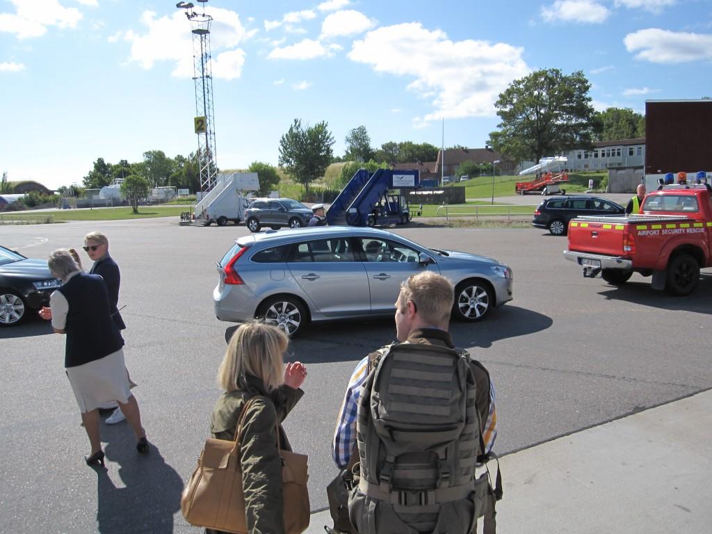 King Carl XVI Gustaf in their Volvo wagon