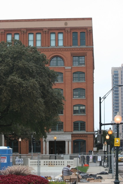 The then Texas School Book Depository building on the left.