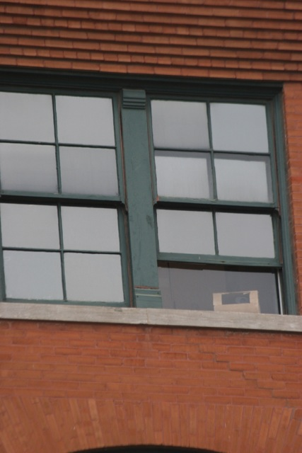 Close-up up of the sixth floor window.