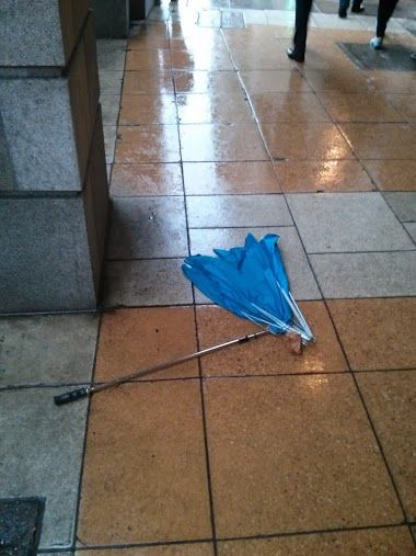 An umbrella destroyed by the high winds