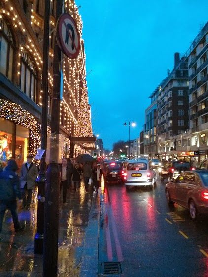 Harrod's was still looking festive despite the storm, and it provided  welcome point of shelter for many - and you could pass the time by shopping or eating.