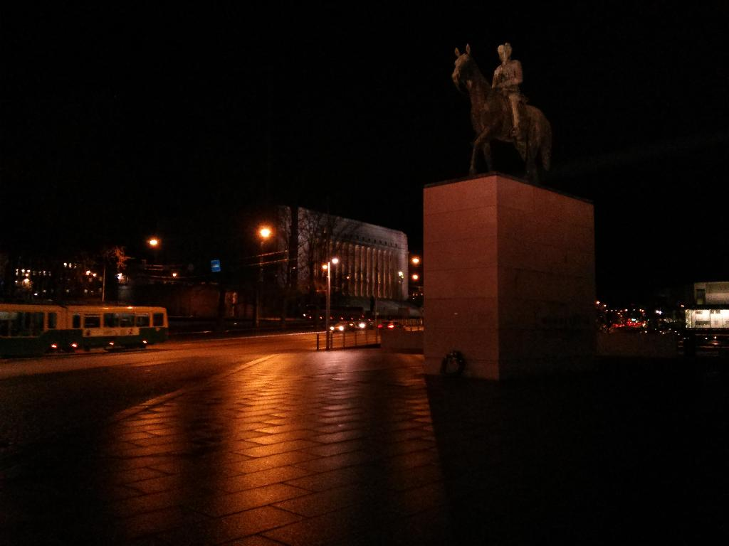 Statue of Carl Gustaf Emil Mannerheim and the Finnish Parliament building in the background