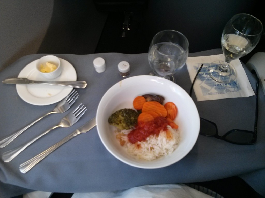 United First Business Vegetarian (strict) Lunch in business First from Europe. It is steamed Broccoli, Carrots and some other vegetable on white rice.