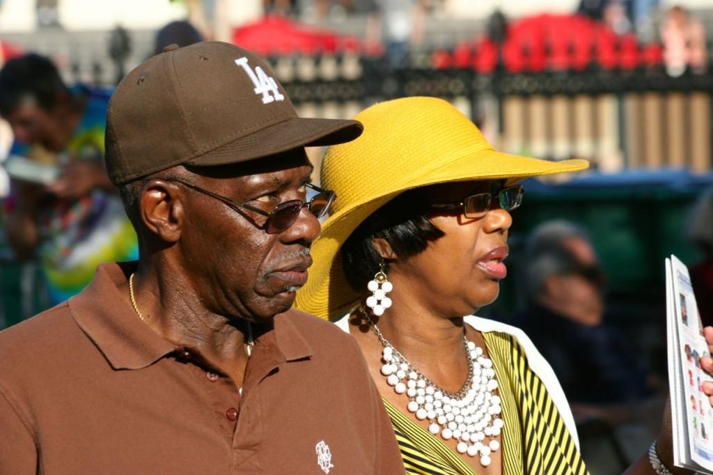 Women like wearing stylish hats in New Orleans.