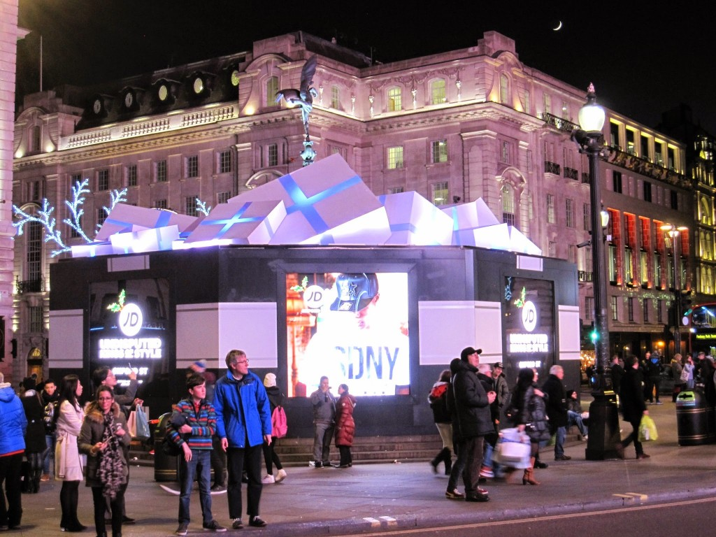 Eros statue in Piccadilly Circus surrounded by Christmas presents