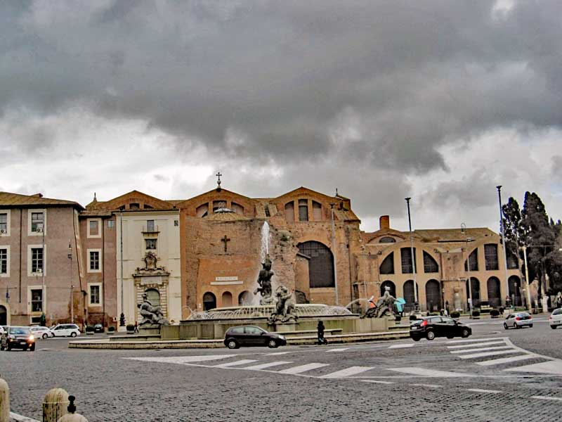 The Diocletian baths seen from across Piazza della Repubblica with The entrance to basilica of Santa Maria degli Angeli e dei Martiri that was later built in the ruins of the baths.