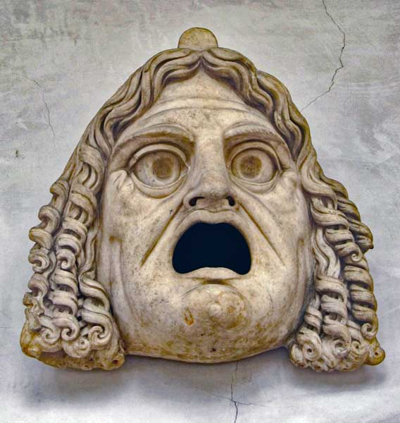 Tragic theatre mask on display in the cloister of the museum.