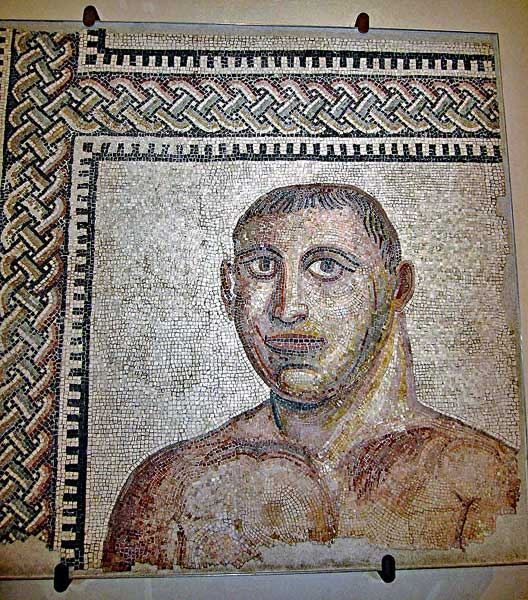A partial mosaic of a boxer from the baths of Caracalla from around 200 AD