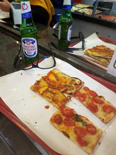 Pizzeria rustica Italia in Rome pizza slices and beer