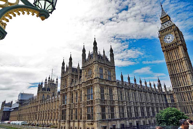 """Palace of Westminster the Parliament building in London with the Elisabeth Tower witch houses """"Big Ben""""."""