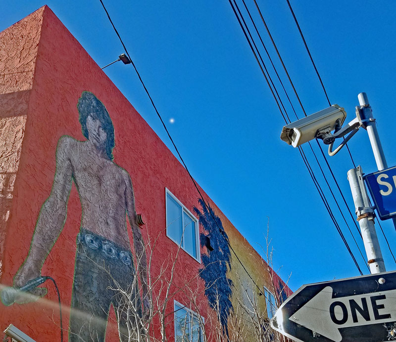 Jim Morrison mural in Venice CA painted by Rip Cronk in 1991. The mural has looked different throughout the years, background color changing and so on.