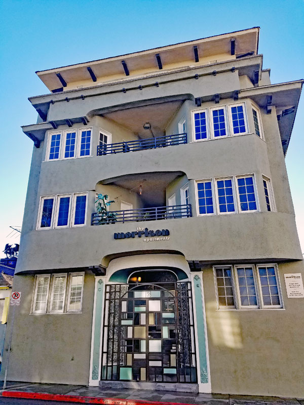 """Jim Morrison lived in this building in 1965, it has since been changed as far as looks go, the structural elements are original, but the sign, color etc. has changed. The current owner is advertising the fact that Jim Morrison lived in the building by naming it """"the Morrison apartments""""."""