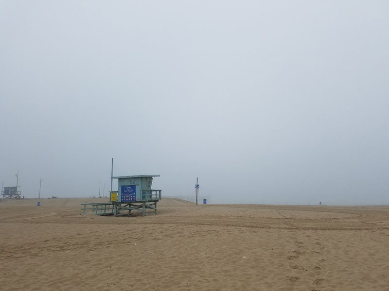 Looking out over the beach with the fogged in Venice Pier in the background.