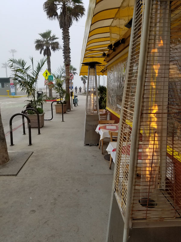 The warm glow of the space heaters at The Terrace at the end of Washington Blvd by the beach feels good on a foggy Monday morning.