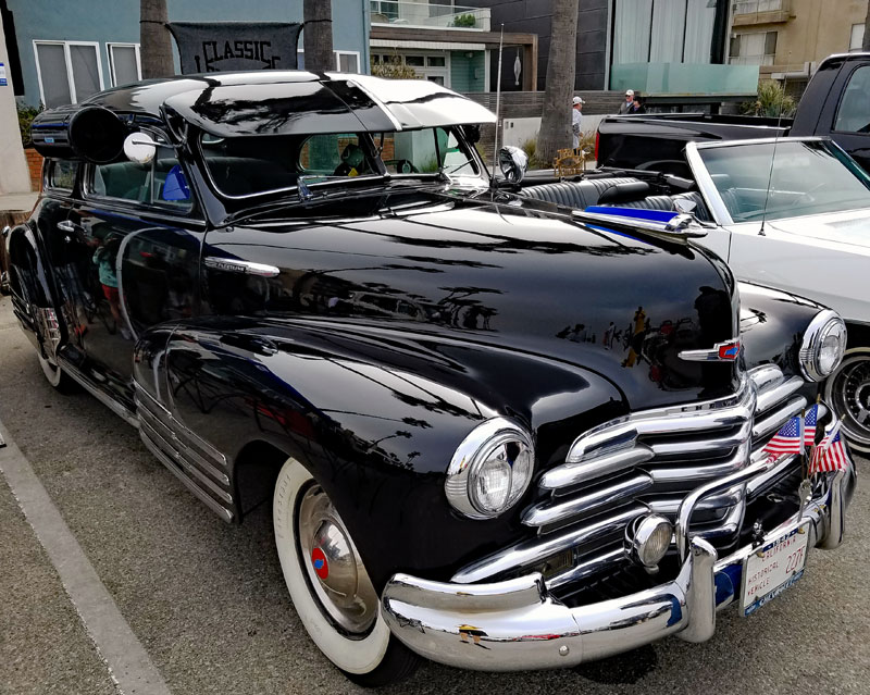 Here is a nice shiny Chevy with exterior sunvisor and a window A/C unit