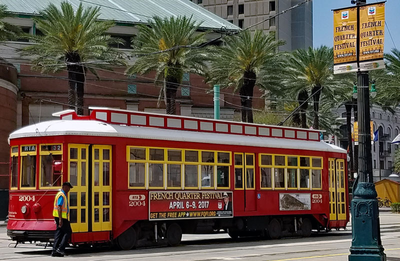Streetcar on Canal Street advertising the French Quarter Fest