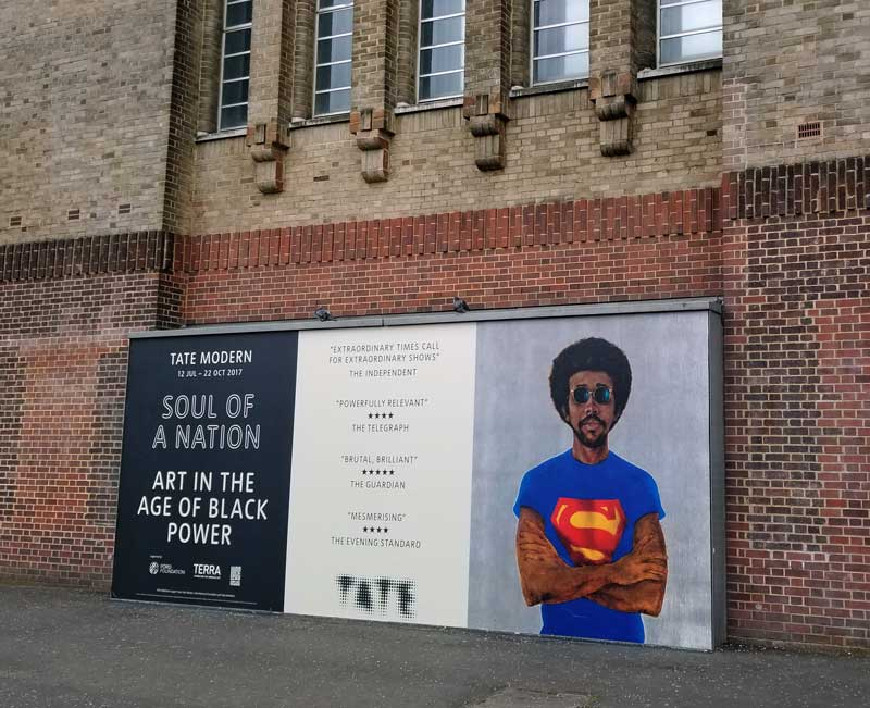 Soul of a Nation poster at Tate modern with Barkley L. Hendricks, Icon For My Man Superman (Superman Never Saved Any Black People--Bobby Seale), 1969. Collection of Liz and Eric Lefofsky.