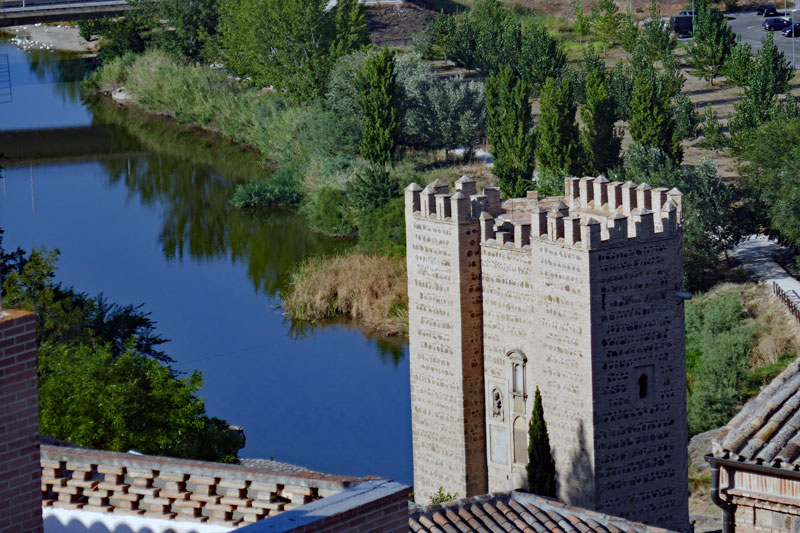 A view from up on the hill just by the Alcazar de Toledo down towards the Tagus river and the Alcántara bridge and gate.