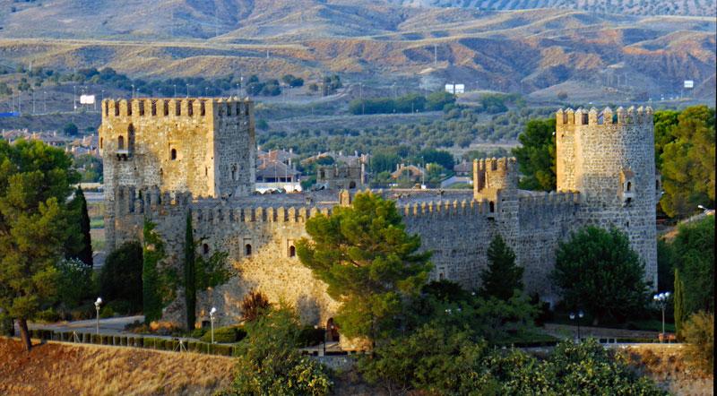 Castillo de San Servando is a Medieval castle just outside the city of Toledo that is now a hostel.