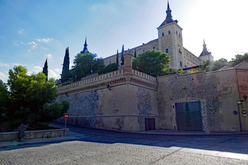 A view of the imposing Alcázar de Toledo on top of the hill.