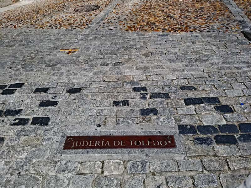 A plaque denoting the area where many of the people belonging to the Jewish faith choose to settle in Toledo.