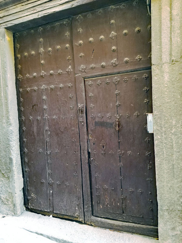 Another imposing and beautiful old Toledo gate with an entry door.