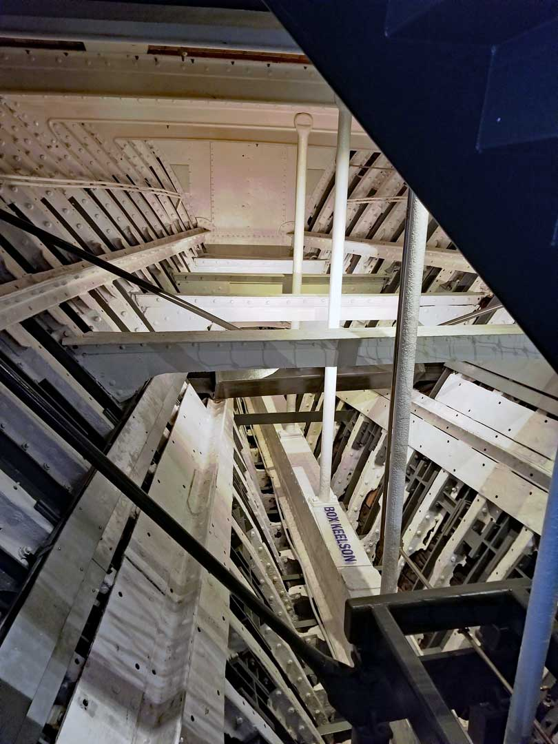 Interior of Cutty Sark with the timbers that make up the hull of the ship.