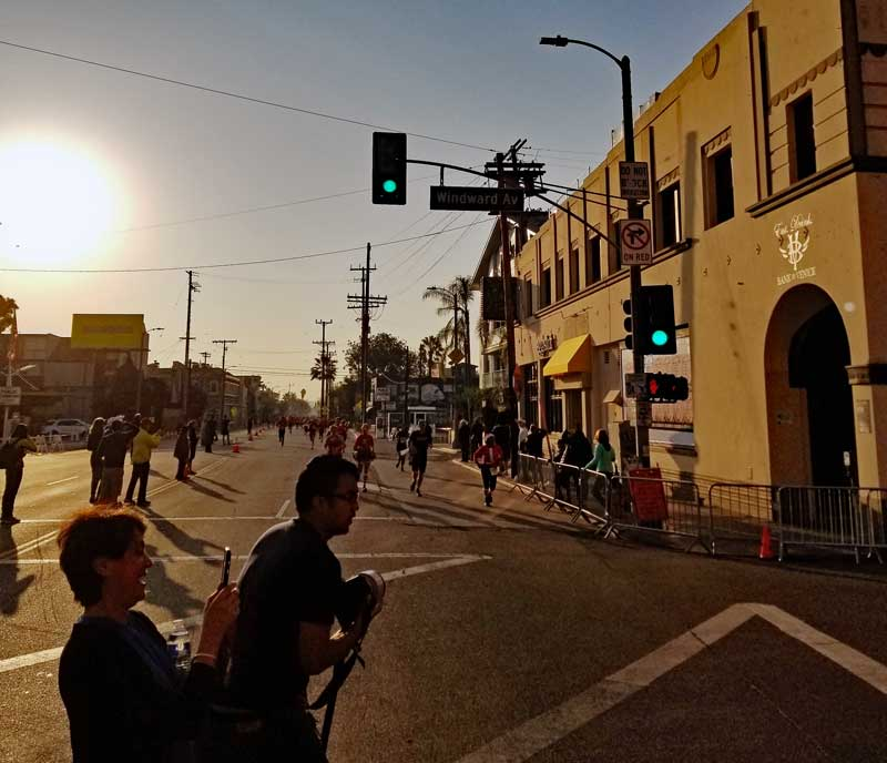 A look at the runners approaching the finish line looking South on pacific from Windward Avenue in Venice.