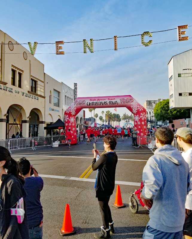 Finish Line under the Venice sign at Windward and Pacific Avenues.