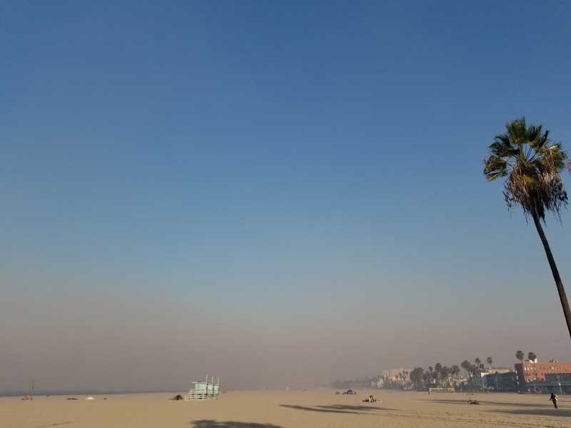 The smoke from the massive fires up towards Ventura County is thick on the beach in Venice.