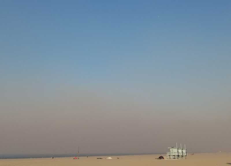 Another look at Venice Beach with the smoke from the fires as a cloud over the beach.