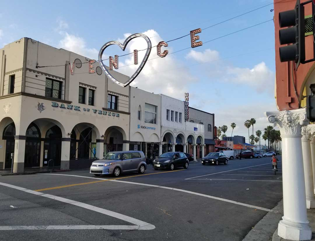 The Venice sign at Windward and pacific with a Valentine's day decoration