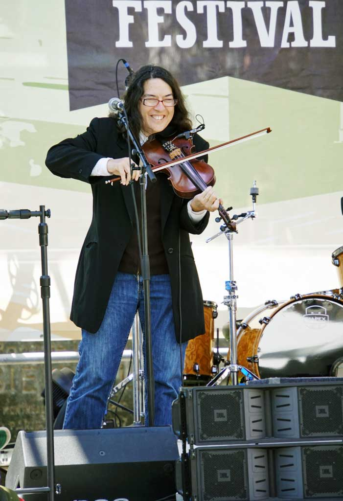 A fiddler on one of the many stages during the 2018 French Quarter Fest.