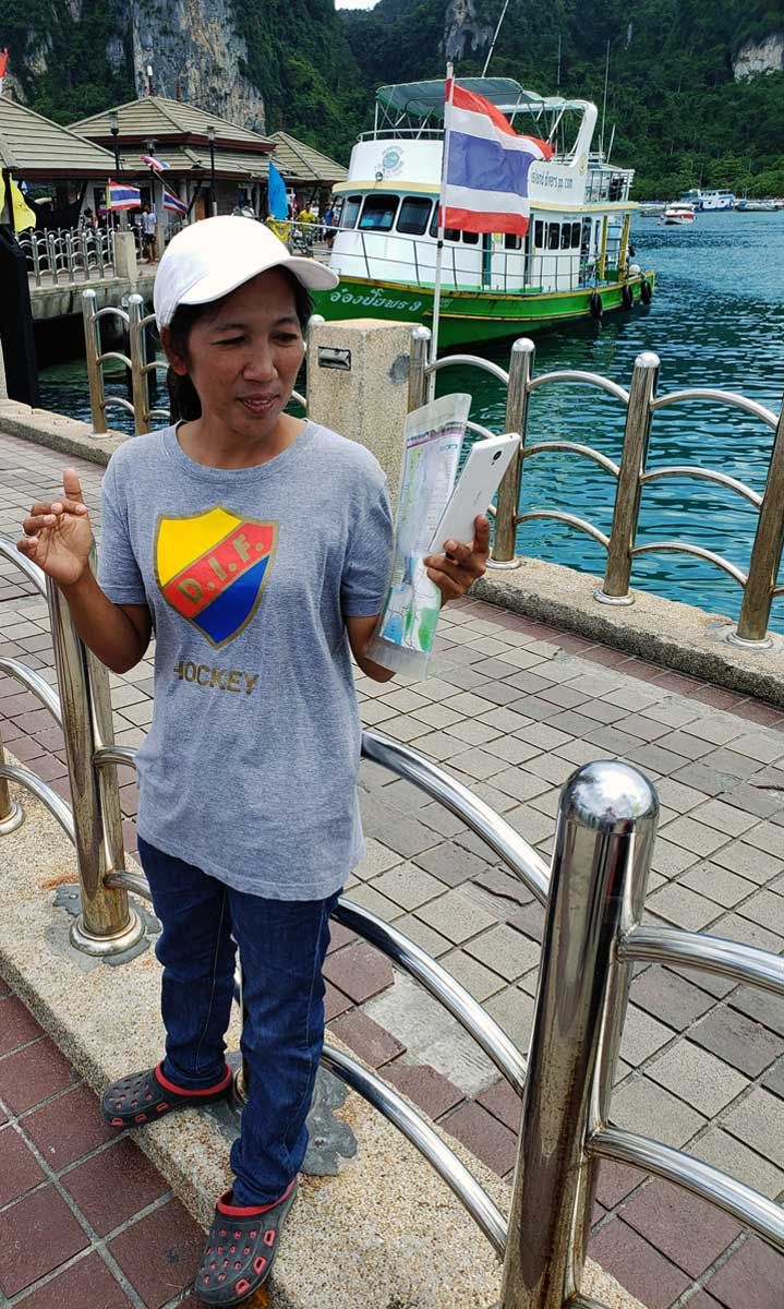 A girl wearing of all things a t-shirt from a Swedish hockey team (Djurgårdens IF) may be among the people greeting yiou upon your arrival on Phi Phi island.