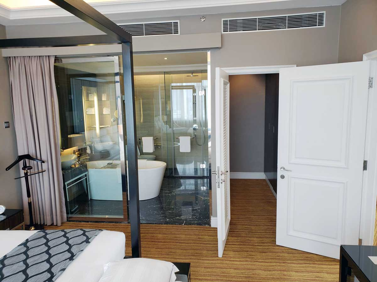 Hotel Majestic 14th floor suite, bedroom with a view of the bathroom.
