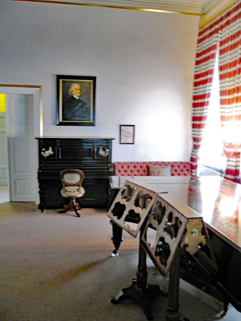 The music salon in the Liszt house contains the original items that would have been there when Liszt lived and worked there. He composed and gave music lessons in this room and on the pianos thet are still there.