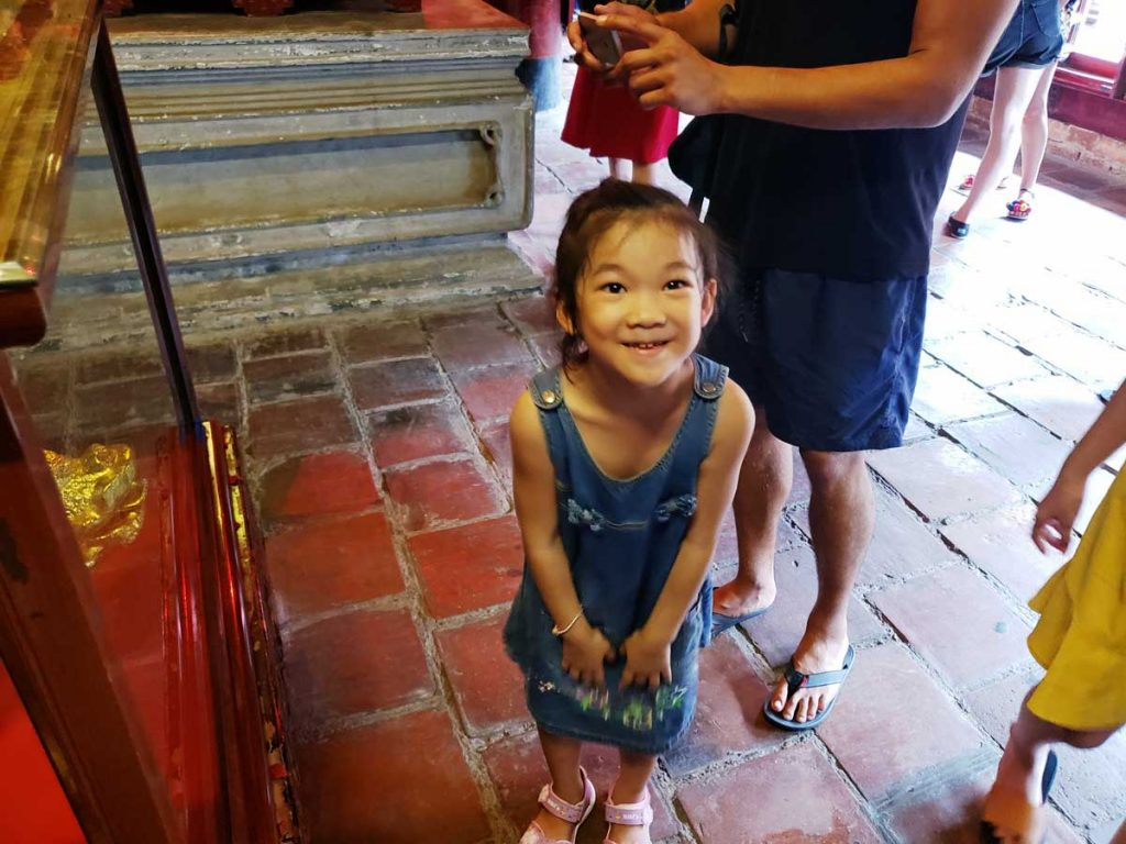 One happy visitor at the Temple of Literature in Ha Noi!