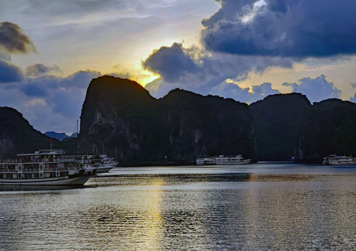 Daylight is starting to light up Ha Long Bay.
