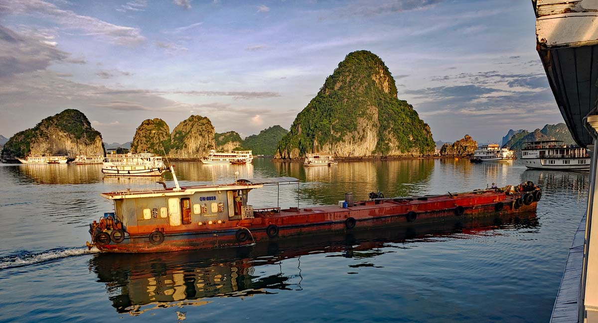 Early morning is the time when the re-fueling barges comes around and refuels the Djonks for another day in Ha Long bay.