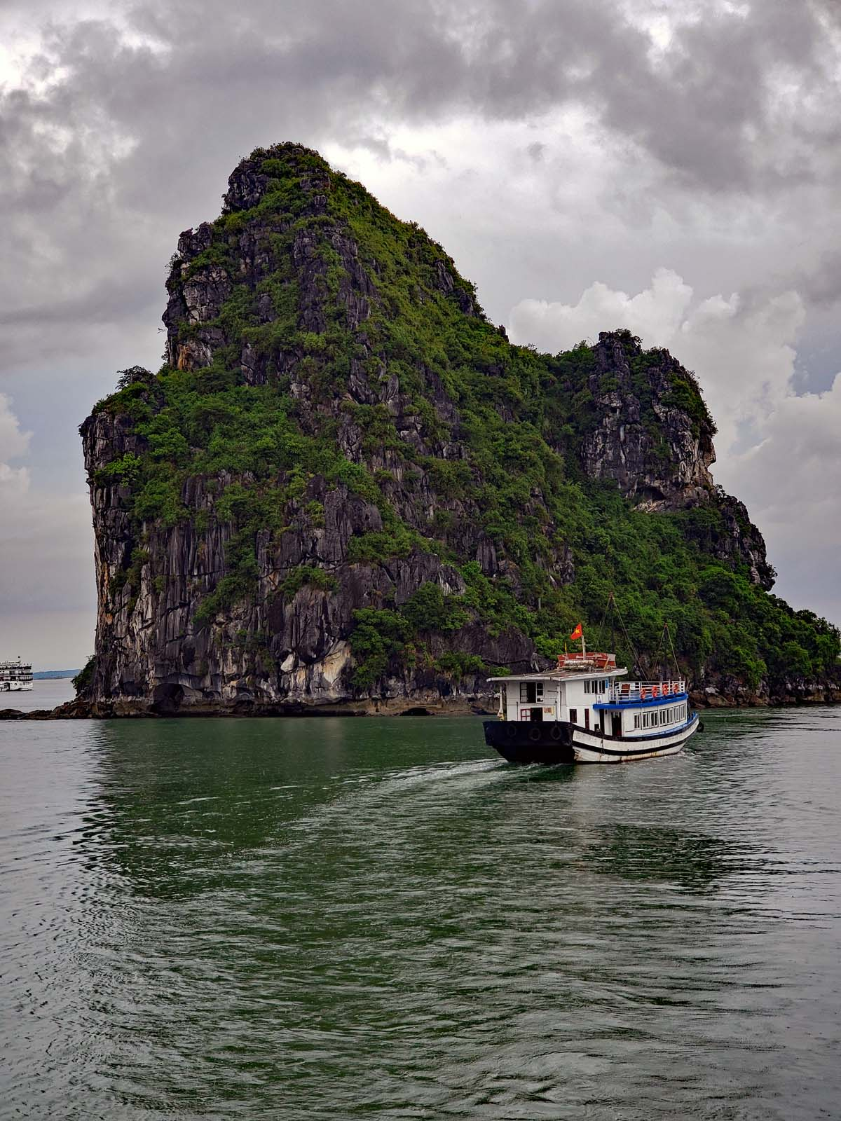 One of the awesome limestone little islet-cliffs in Ha Long Bay.