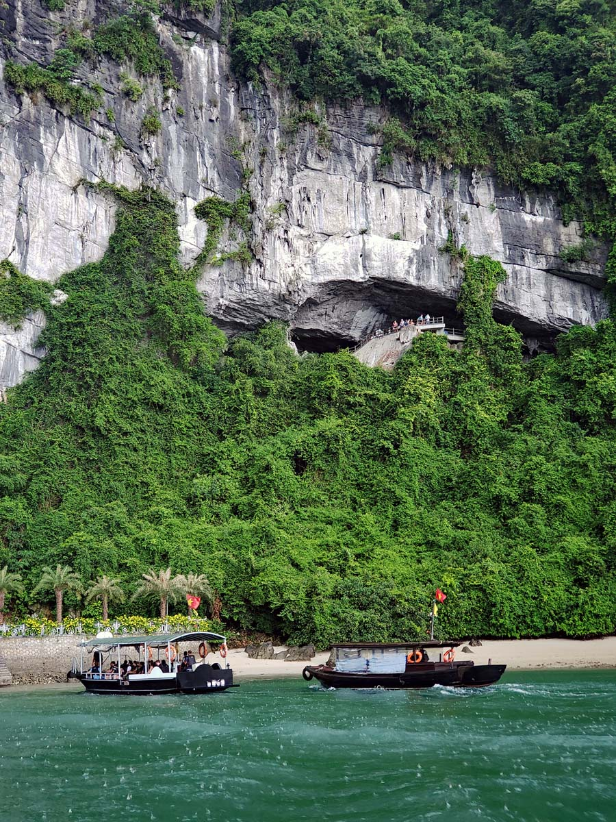 Tenders carrying visitors to the cave coming into the harbor during a light rain.