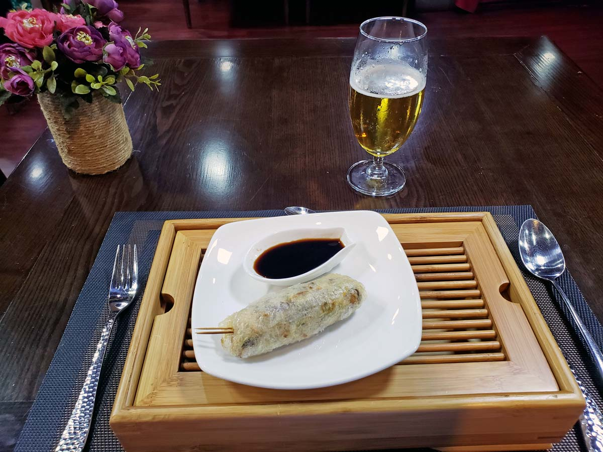 My own handmade vegetarian spring roll! With a Ha Noi Beer!
