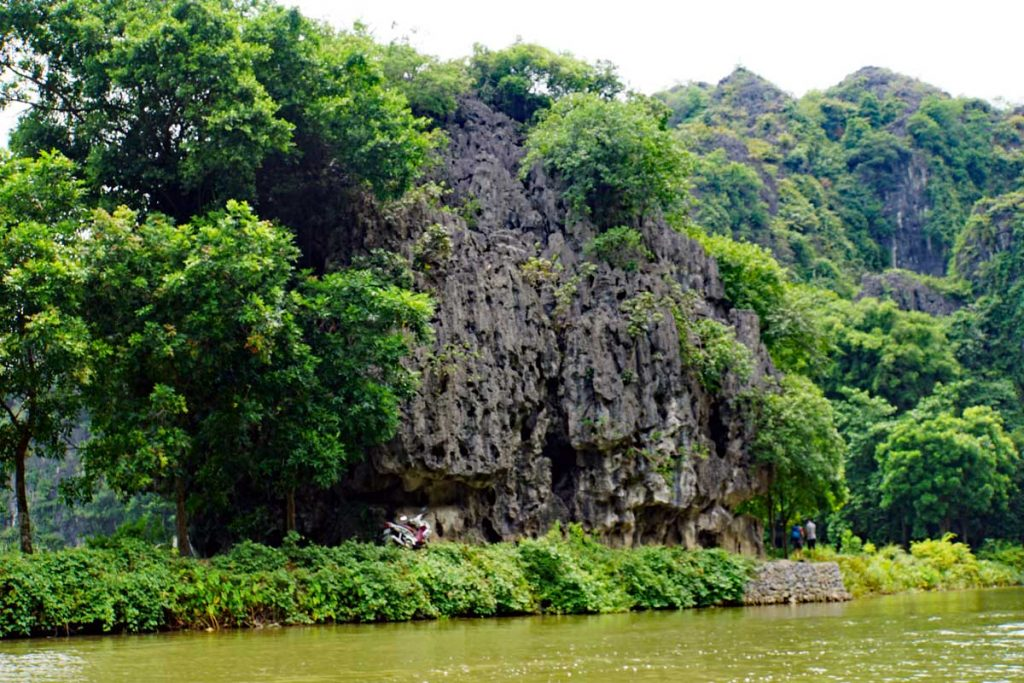 Limestone formations line the river.
