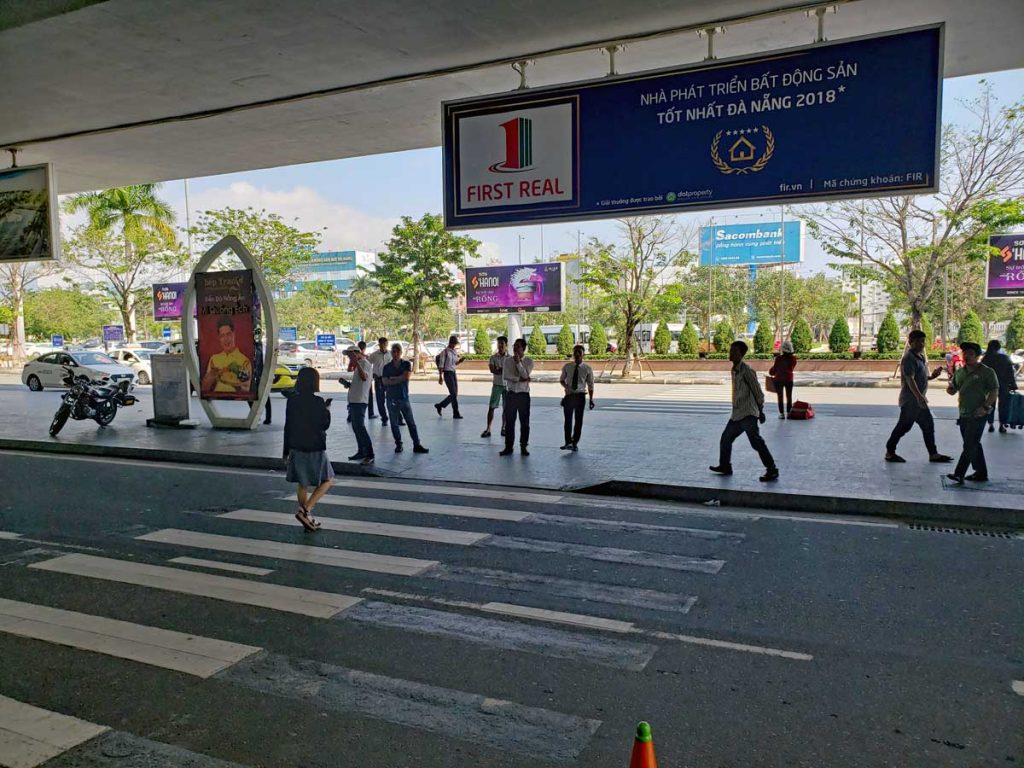 Da Nang International Airport (DND) Arrival, with the usual scam artists and taxi customer wranglers.