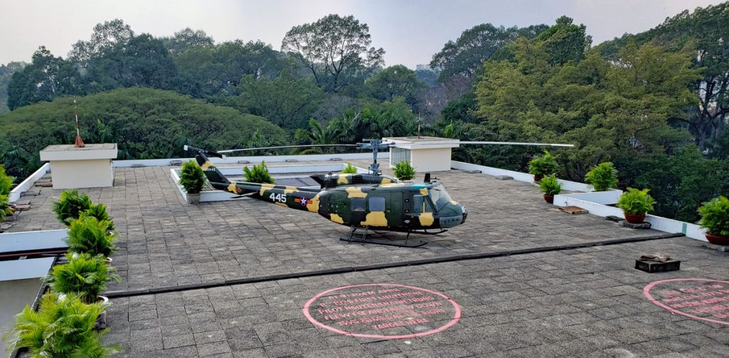 The circles in the picture in front of the Huey represents where the two bombs dropped on the Palace April 8 1975 hit the helipad.