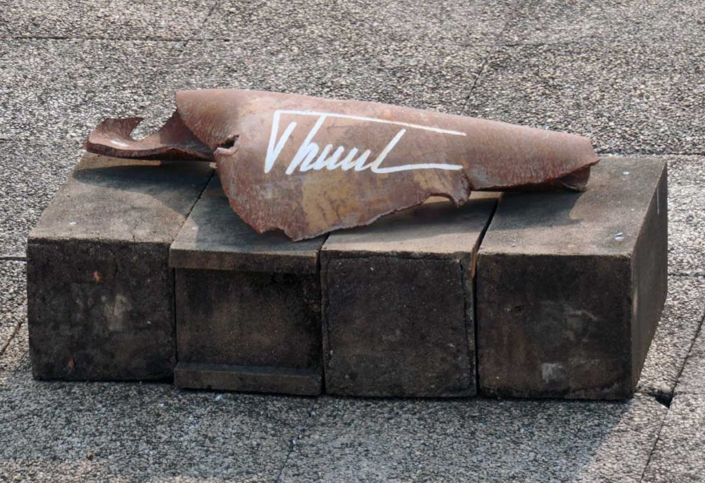 Closeup of the autographed shrapnel.