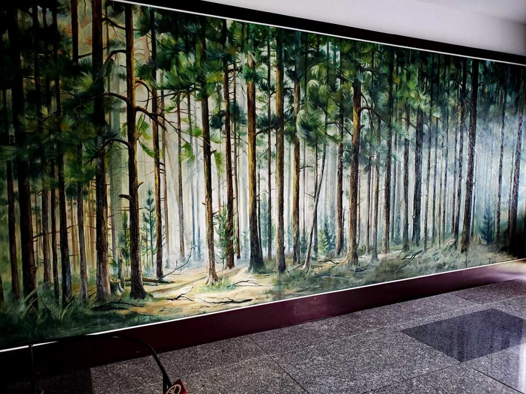 A nice Pine forest adorns the wall behind the Grand Piano.