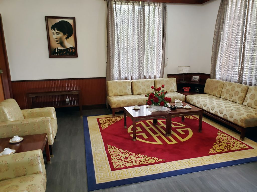 A view of the sitting area of the VP office with a picture of the wife of 	Nguyễn Lương Bằng, the last VP to occupy the office.
