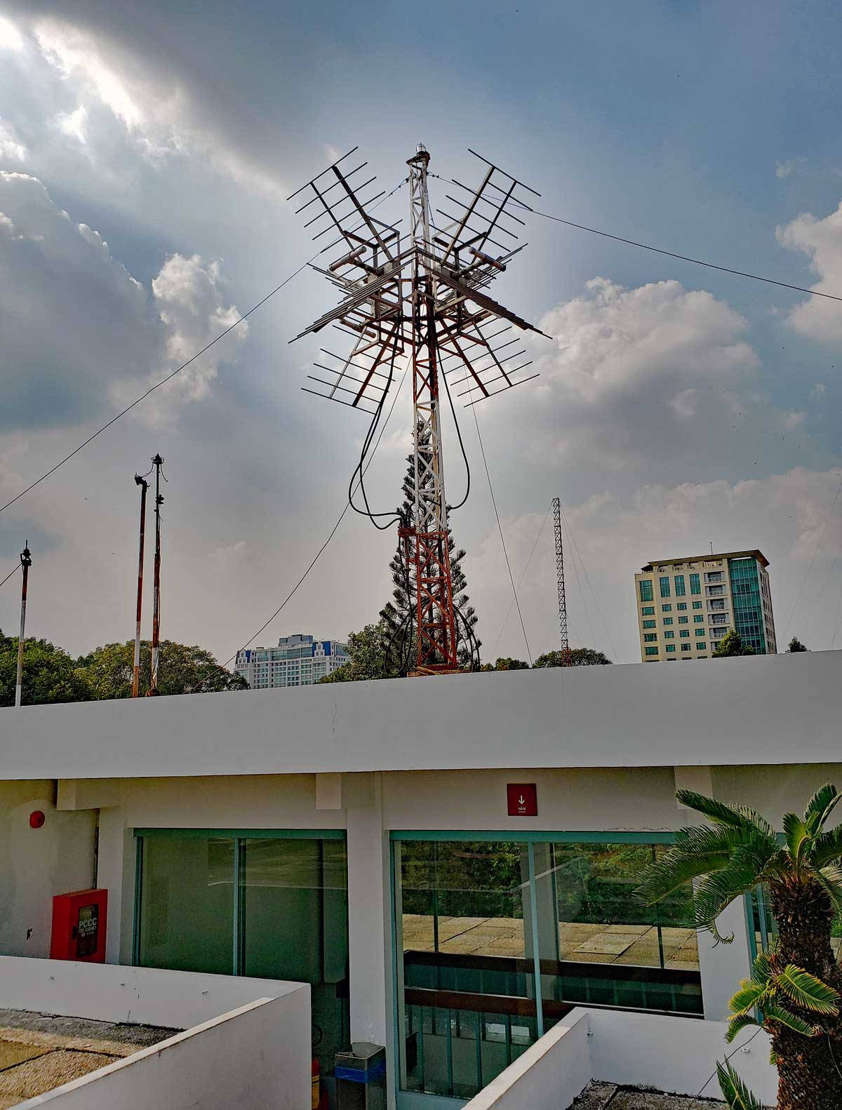Communication equipment antennas on top of the roof.